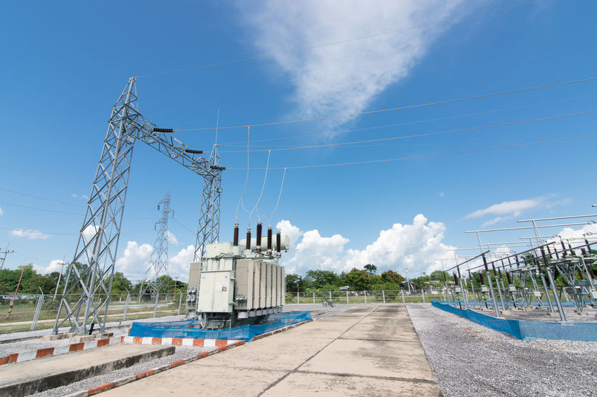 View of electrical field with blue cloudy sky AMPt_community City Electrical Pole Grid High Voltage Perspective Substation Blue Sky Close-up Consumer Controller Electical Power Electrical Power Electricity  Energy Generator Power Line  Power Supply Renewable Energy Resources Safety Scada Smart Grid Storage Transformers