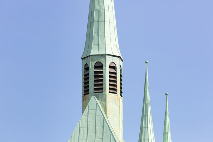 Close up of roof top of a church against clear sky Architecture Blue Building Exterior Built Structure Christianity Church City Clear Sky Close-up Green Color High Section Low Angle View Copy Space Old Pastel Colored Patina Place Of Worship Religion Rusty Simplicity Sky The Past Tower Travel Destinations Weathered