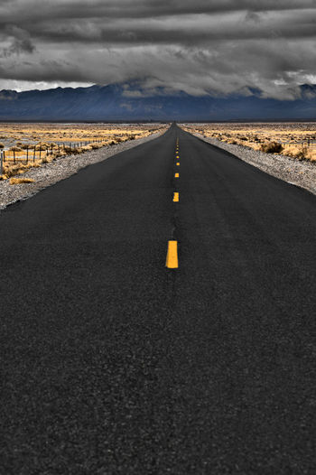 Road Transportation The Way Forward Direction Symbol Sign Road Marking Cloud - Sky Marking Sky Diminishing Perspective Asphalt No People vanishing point Nature Empty Road Dividing Line Scenics - Nature Tranquil Scene Tranquility Outdoors Surface Level Long
