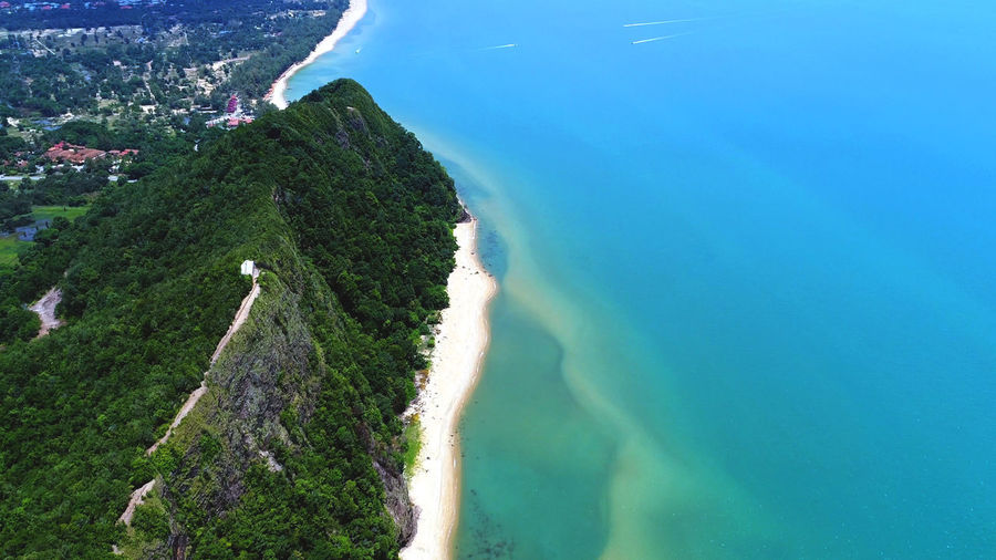 Beautiful coastline with emerald colored ocean. Aerial View Aerial, Ocean, Sea, View, Travel, Summer, Blue, Water, Beach, Tropical, Nature, Drone, Vacation, Landscape, Top, Coast, Beautiful, Sand, Island, Shore, Turquoise, Holiday, Paradise, Background, Wave, Seascape, Relaxation, Above, Tourism, Wallpaper, Outdoo Beach Beauty In Nature Day High Angle View Landscape Mountain Nature No People Outdoors Scenics Sea Sky Tree Water