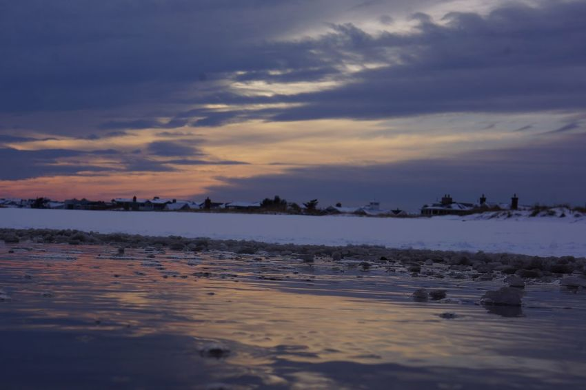 Sunset snow and surf Sky Sunset Water Nature Scenics Beauty In Nature Tranquility Tranquil Scene Beach Sea Silhouette