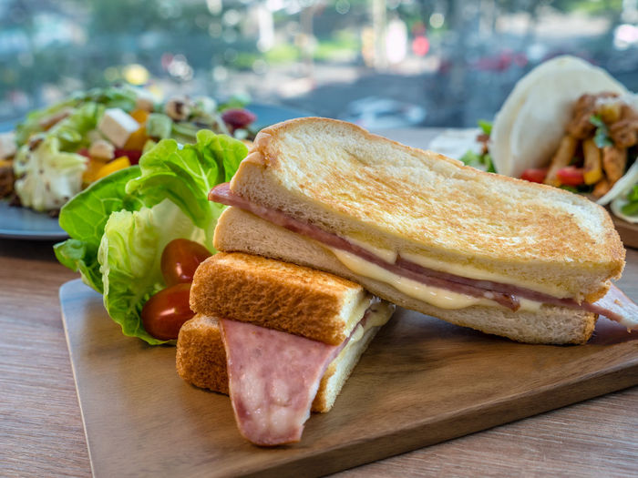 Panini ham and cheese, Italian delicious fast food. A panini or panino is a grilled sandwich made from bread other than sliced bread. Tray Bread Breakfast Cheese Focus On Foreground Food Food And Drink Freshness Ham Healthy Eating Meal Meat Panini Processed Meat Ready-to-eat Sandwich Serving Size SLICE Sliced Bread Snack Still Life Table Temptation Vegetable Wooden