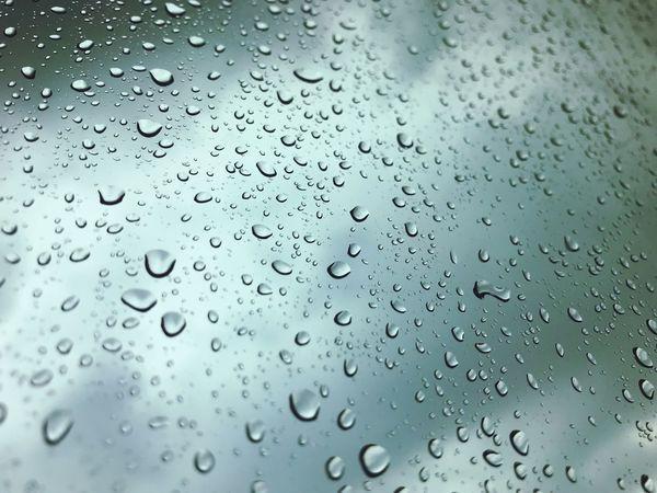 It's raining outside. Drop Wet Rain Water Full Frame Backgrounds Window Glass Rainy Season