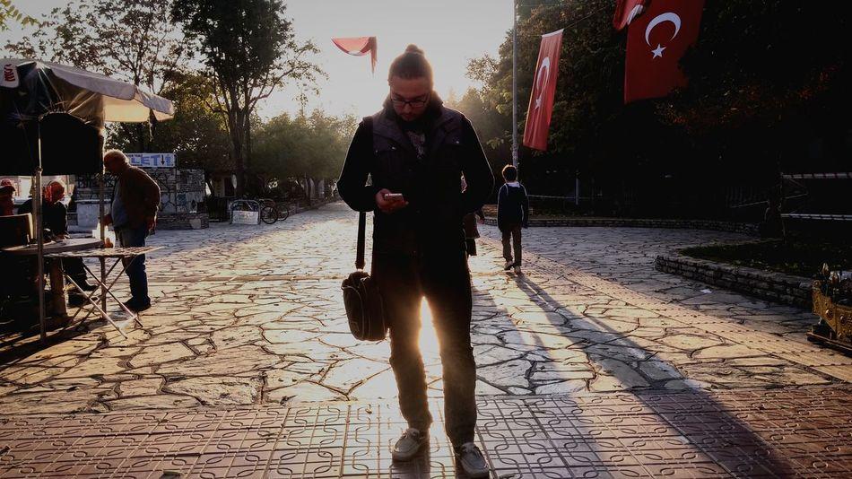 Friend Smartphone Streetphotography Mugla Turkey Sunset Life On Street Boy With Phone Urban Here Belongs To Me The Street Photographer - 2016 EyeEm Awards