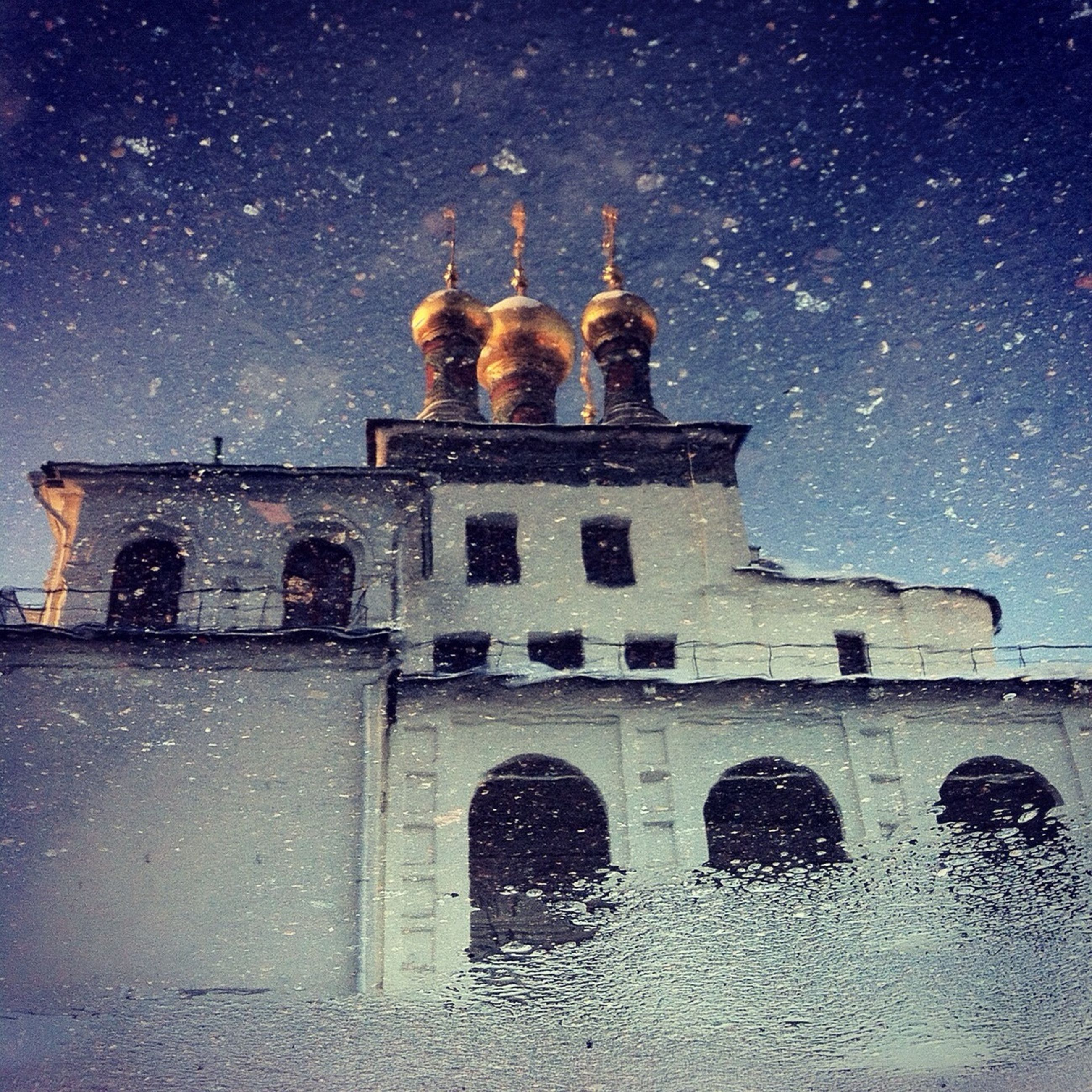 night, building exterior, architecture, built structure, sky, low angle view, snow, illuminated, cold temperature, winter, star - space, weather, religion, history, window, season, church, facade, no people