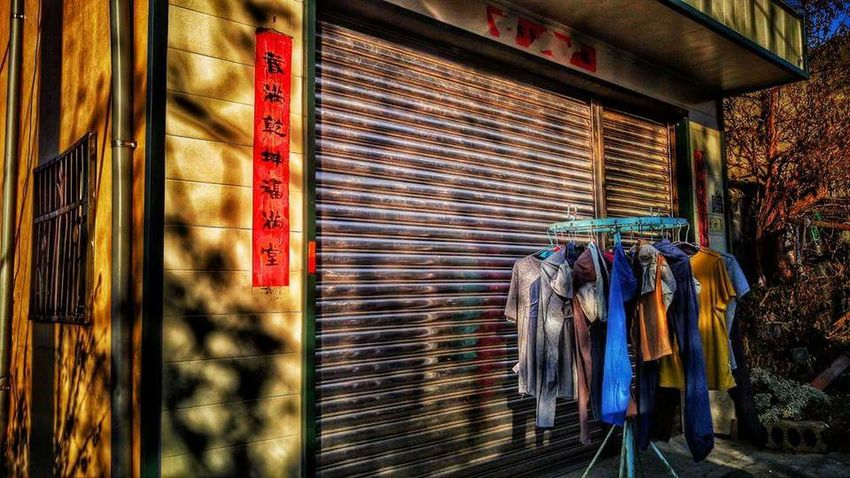 Hanging Clothing Clothes Rack Multi Colored No People Outdoors Light And Shadow Shadows & Lights Streetphotography Ontheroad Enjoying The Sun OnTheCar Take Photos House Colorful