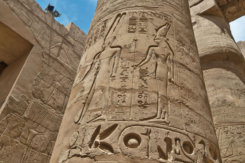 Ancient Ancient Civilization Archaeology Architecture Bas Relief Built Structure Carving - Craft Product Day Egypt History No People Old Ruin Outdoors Place Of Worship Queen - Royal Person Religion Sculpture Sky Travel