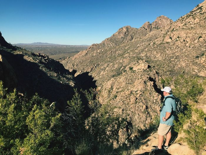 High angle view of man standing against mountains