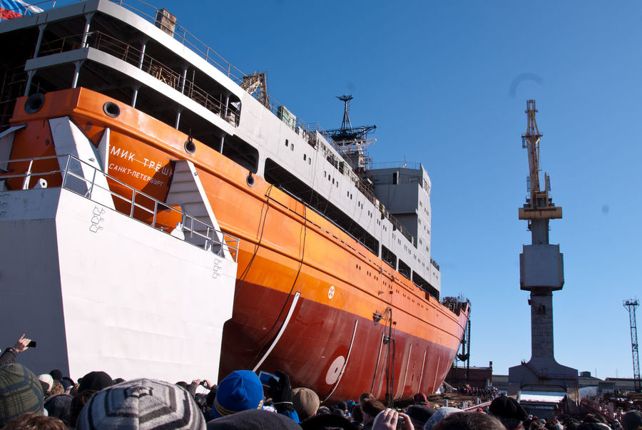 """The launch of the research vessel """"Akademik Tryoshnikov"""" at the St.Petersburg Admiralty Shipyard, March 29, 2011 Blue Hull Launch Of The Vessel Outdoors People Research Vessel Shipyard Shipyard Crane Shipyardlife Sky Snow Sunny Vessel Winter"""