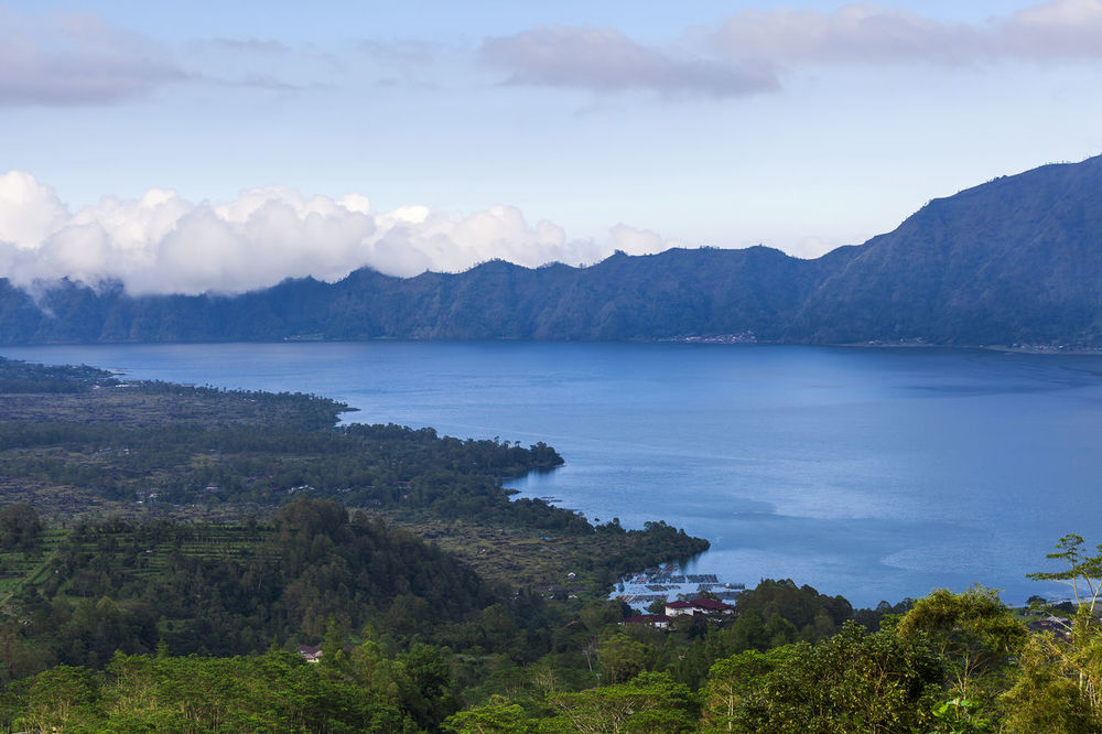 Lake Batur in the crater of the volcano, Indonesia, Bali Bali INDONESIA Beauty In Nature Cloud - Sky Day Idyllic Lake Batur Landscape Mountain Mountain Range Nature Non-urban Scene Outdoors Plant Scenics - Nature Sky Tranquil Scene Tranquility Tree Volcano Water