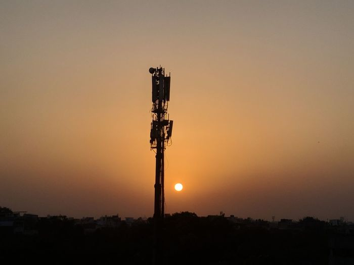 Raw Sunset Sky Technology Orange Color Silhouette Communication Architecture Nature No People Built Structure Copy Space Beauty In Nature Connection Sun Outdoors Scenics - Nature Tower Illuminated Tranquility Telecommunications Equipment