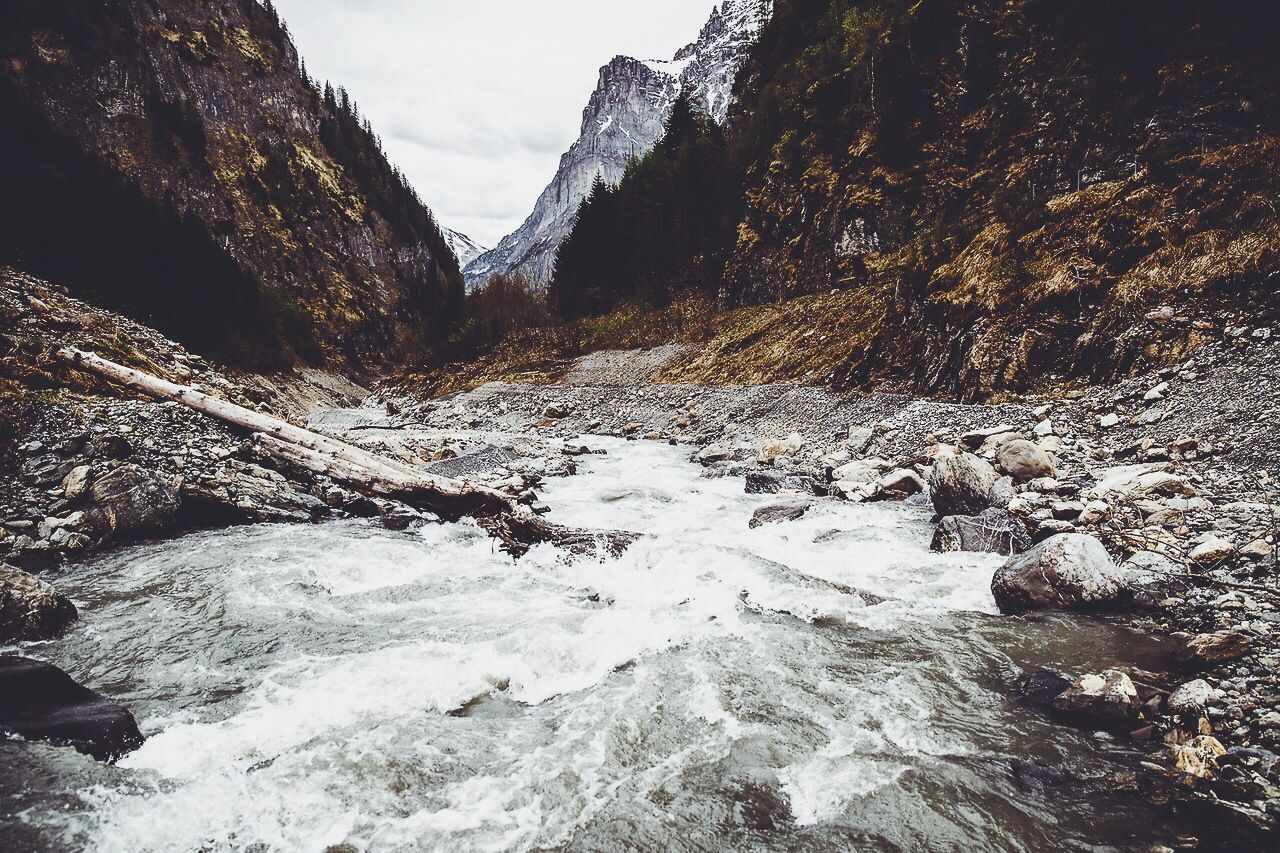 River flowing against rocky mountains