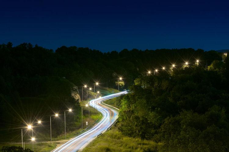 Illuminated Light Trail Motion Night Night Lights NightRoad Nightshot No People Outdoors Road Sky Star - Space Transportation Tree