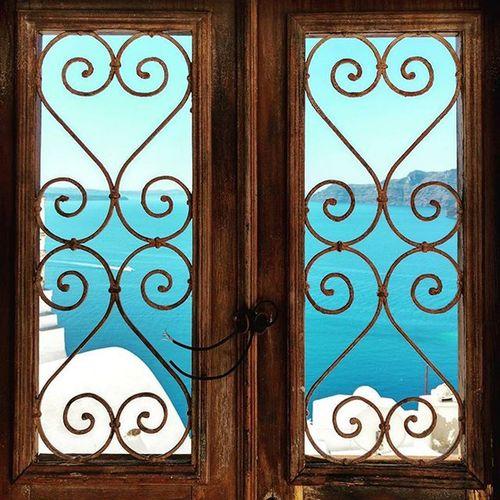 Behind open closed doors. Santorini Caldera Oia AndronisExperience Greece