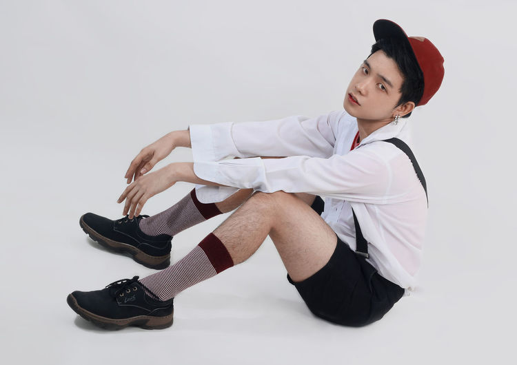 Casual Clothing Fashion Formalwear Full Length Indoors  Lifestyles One Person Real People Sitting Studio Shot Well-dressed White Background Young Adult Young Men Young Women The Week On EyeEm