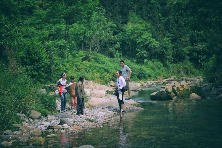 The Great Outdoors - 2017 EyeEm Awards The Human Condition Real People Green Color Tree Standing Outdoors Nature Day Grass Togetherness Lifestyles Water Forest People Friendship Beauty In Nature Adults Only Nature