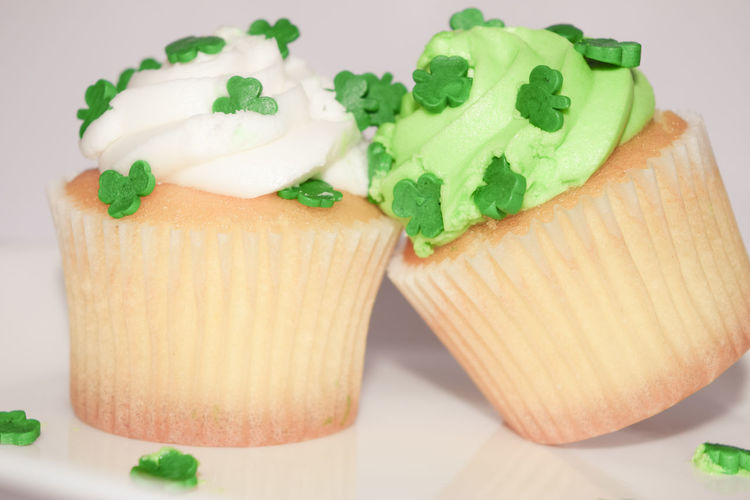 Close-up of cup cakes over white background