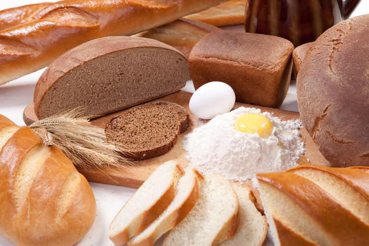 Fresh bread, bakery products with eggs and flour on the breadboard Bakery Bread Breadboard Brown Brown Bread Cereals Close-up Cooking Day Egg Flour Food Food And Drink Freshness No People Ready-to-eat Wheat
