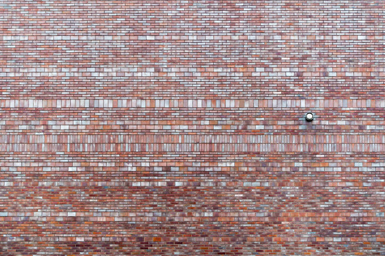 Full frame shot of red brick wall