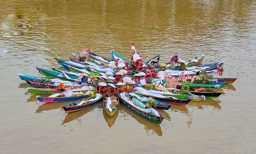 High angle view of multi colored boats on river