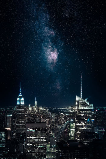 Cityscape With Empire State Building Against Sky At Night
