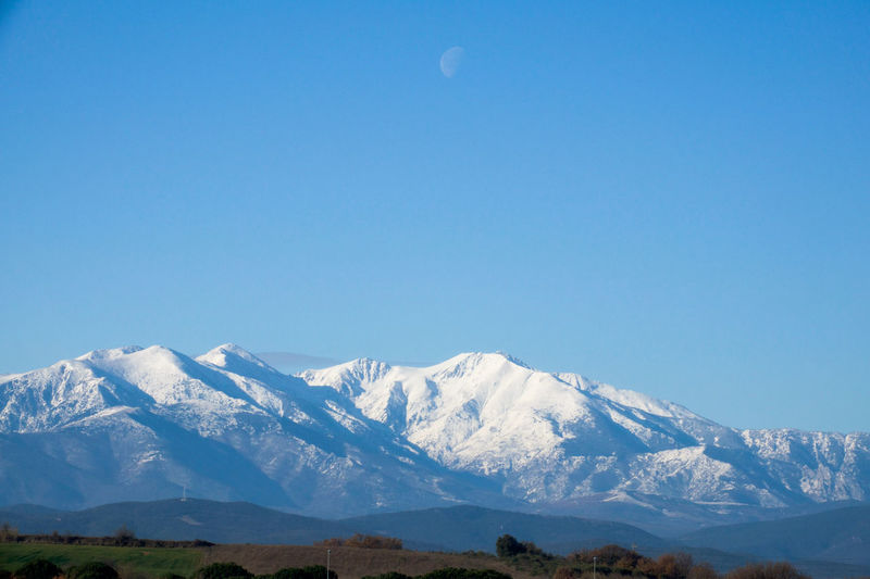 Beautiful day, crisp and cold in sunny Catalunia Beauty In Nature Blue Sky No Clouds Canigou Mountain Cat Clear Sky Fading Moon French Catalan Landscape_Collection Moon Mountain Range Outdoors Pyrenees National Park Snow Covered Winter