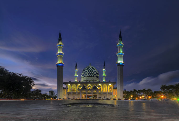 Masjid Shah Alam during blue hour in slow shutter mode. Blue Hour Architecture Building Exterior Built Structure City Cloud - Sky Dome History Illuminated Low Angle View Nature Night No People Outdoors Place Of Worship Religion Shah Alam Mosque Sky Slow Shutter Spirituality Tourism Travel Travel Destinations Tree Water The Traveler - 2018 EyeEm Awards
