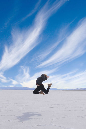 Sky One Person Land Cloud - Sky Leisure Activity Real People Nature Side View Beauty In Nature Mineral Tranquility Tranquil Scene Salt Flat Scenics - Nature Lifestyles Day Environment Jumping