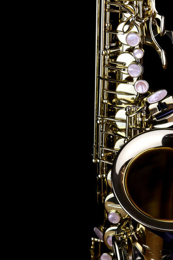 Music Instrument Alto Saxophone, Saxophone Isolated on black Musical Instrument Music Arts Culture And Entertainment Studio Shot Musical Equipment Indoors  Wind Instrument Brass Instrument  Metal Close-up Saxophone Brass Black Background Gold Colored Copy Space No People Single Object Shiny Jazz Music Still Life Silver Colored Blue Background