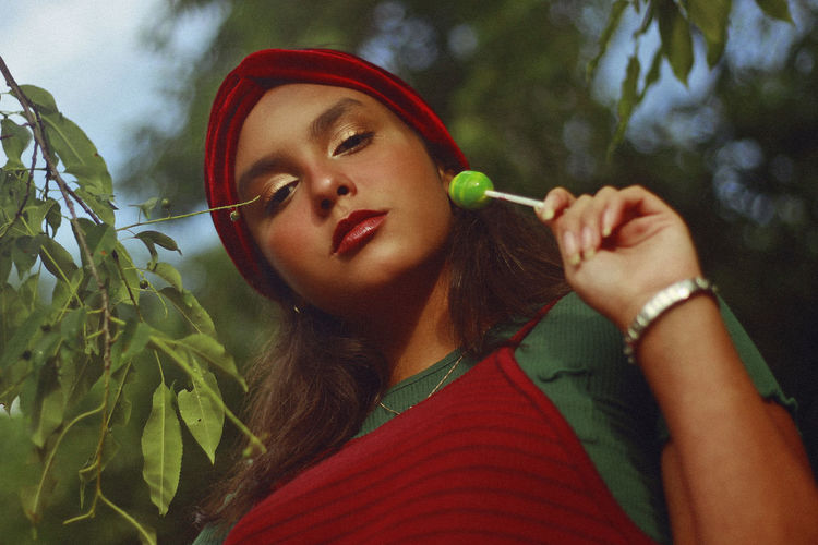 Close-up portrait of teenage girl eating lollipop