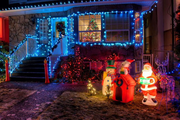 Illuminated christmas lights on building at night