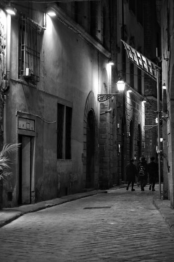 Florence Street By Night Night Illuminated Built Structure Architecture Building Exterior People City Mystery Street Winter Shadow Window Outdoors Casting A Shadow Contrast Travel City Shadows & Light Shadows Black And White Monochrome The Best City In The World Florence Italy Florence Street Photography