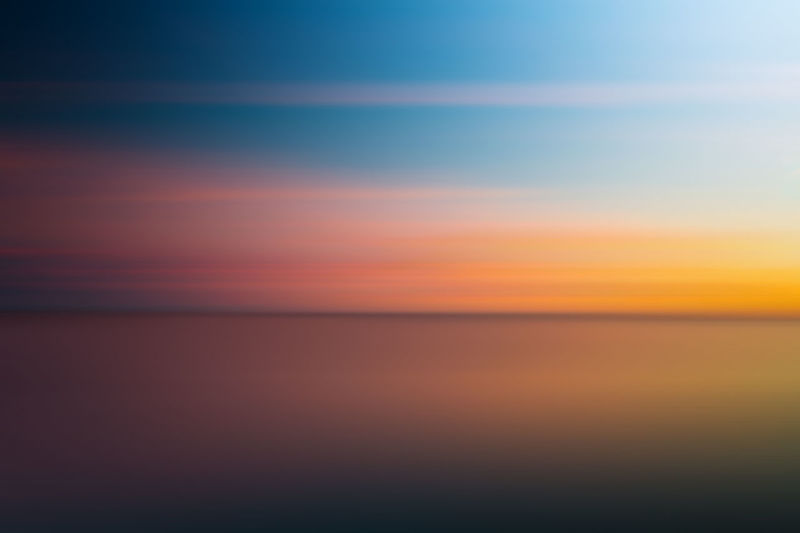 Tranquility Tranquil Scene Water Sea Horizon Over Water Horizon Scenics - Nature Sky Beauty In Nature Sunset Idyllic No People Nature Blue Orange Color Backgrounds Urban Skyline Reflection Dusk Abstract Abstract Backgrounds