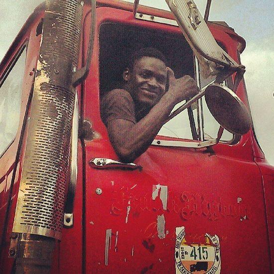 Happy Trucker! Smile Nigeria Nigerians Red retro vintage traffic truck lagos lagosnigeria snapitoga