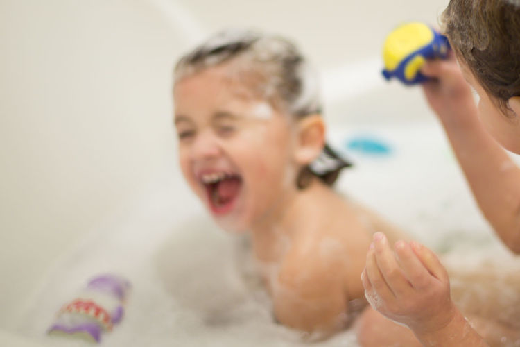 Close-Up Of Boy With Brother In Bathtub