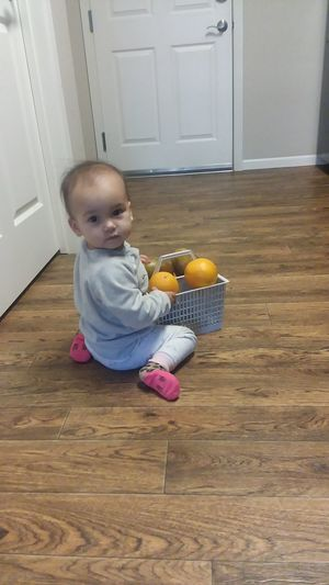 Baby Girl with fruits Baby Photo  Campaign Advertising Advertisement Marketing Baby Serious Fruit Tree Fruits Basket Looking At The Camera Baby Girl With A Fruits Basket Baby Photos Photos Fruits Baby Fruits Baby Full Length Childhood Portrait Cute Hardwood Floor Baby Home Interior Babyhood