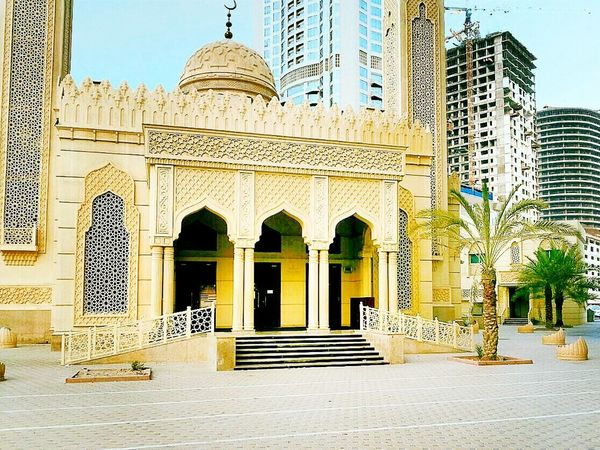 Built Structure Building Exterior Religion Architecture Architectural Column Outdoors Office Building History Exterior Spirituality Arch Sharjah Uae Dubai Sharjah Sky Built Structure Building Exterior Architecture Religion Spirituality Place Of Worship City Window Arch Travel Destinations