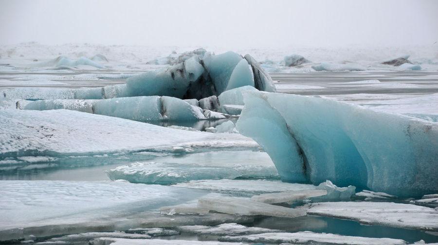 Idyllic Shot Of Glacier On Sea Against Sky