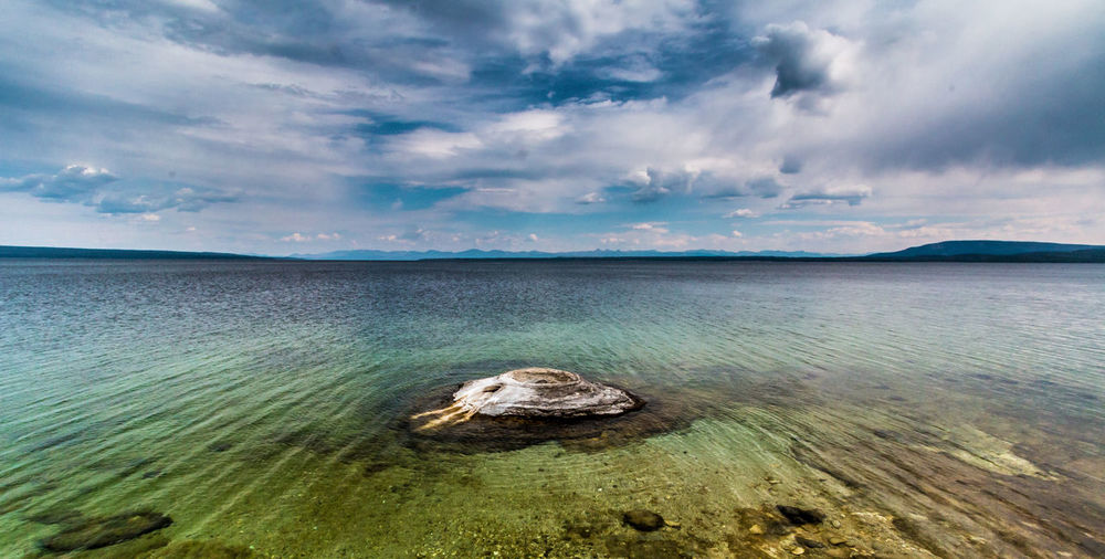 Fishing Cone geyser in Yellowstone Lake Geyser Pool Landscape_Collection Pond Yellowstone Yellowstone National Park Yellowstone National Park. Beach Beauty In Nature Cloud - Sky Fishing Fishing Cone Geology Geothermal  Geyser Lake Land Landscape Landscape_photography Nature Outdoors Scenics - Nature Sky Tranquil Scene Water Waterfront EyeEmNewHere #FREIHEITBERLIN The Great Outdoors - 2018 EyeEm Awards The Traveler - 2018 EyeEm Awards