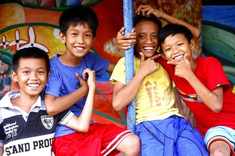 young Asian children smile and pose for the camera ASIA Asian  Philippines Young Youth Of Today Kids Children Portrait Portrait Photography Smile Smiling Happy Happiness Laugh Laughing Laughter Boys Males  Friendship Togetherness Cheerful Group Of People Happiness Social Gathering Smiling