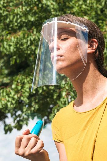 Close-up woman using hand fan
