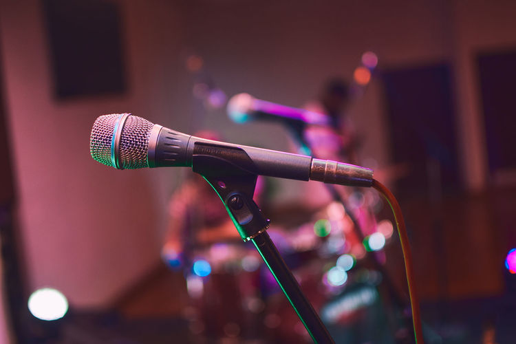 Close-Up Of Microphone Against Illuminated Lights