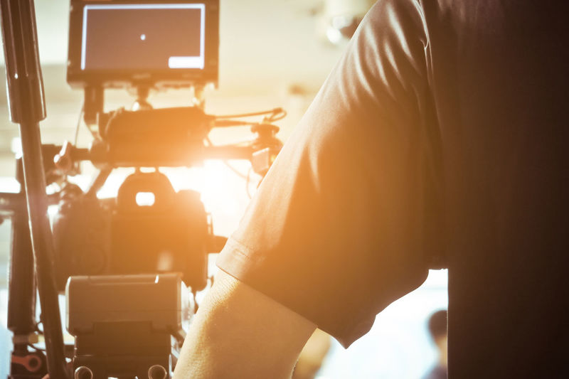 Close-up of man working with movie camera
