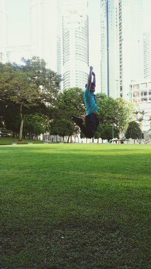 City Grass One Person Tree Outdoors Skyscraper Sky Nature Building Suria KLCC Park Stayfit FitMalaysia2017