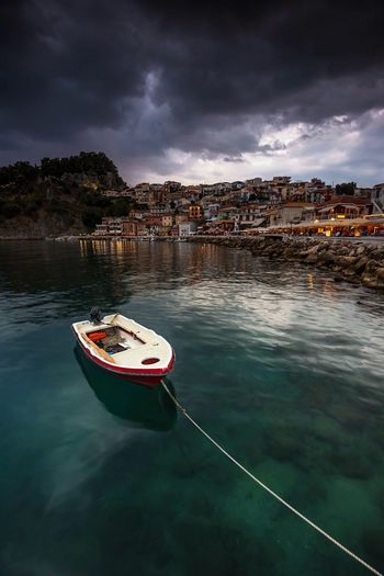 Tethered Parga Greece Greek Summer Greek Holiday Blue Blue Sea Nautical Vessel Boat Rowboat Moored Transportation Architecture Venetian Sea And Sky Seascape Harbour Scenics Beauty In Nature Storm Cloud Floating On Water Waterfront Holiday POV Cloud - Sky Perspectives On Nature Summer Exploratorium The Great Outdoors - 2018 EyeEm Awards The Traveler - 2018 EyeEm Awards