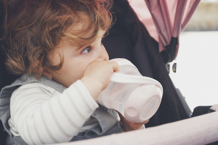 Portrait of cute boy drinking coffee