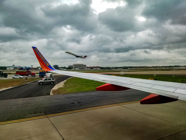 Flying Cloud - Sky Air Vehicle Sky Day Outdoors Landscape Nature Airplane Runway Airport Landing Airport Runway Window Seat Airplane Wing Window Seat Transportation Motion May 2017 Southwest Airlines Commercial Airplane Aircraft Wing Airportphotography Clouds Taking Off Plane Neighborhood Map The Traveler - 2018 EyeEm Awards