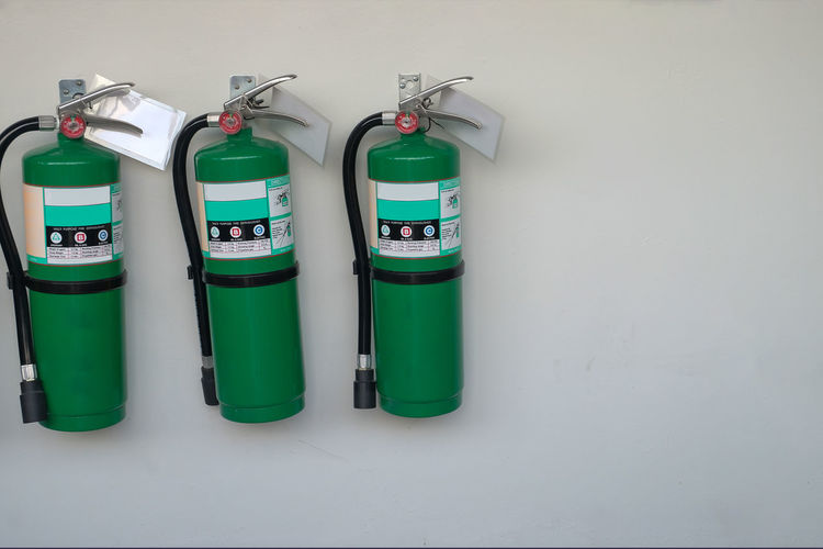 green fire extinguisher Fire Fighting Electronics Industry Protection Prevention Careful Close-up Pipes Fire Hose Equipment Safety Carbondioxide Fighting Fire Extinguisher Environmental Conservation Green Color Fire Hydrant