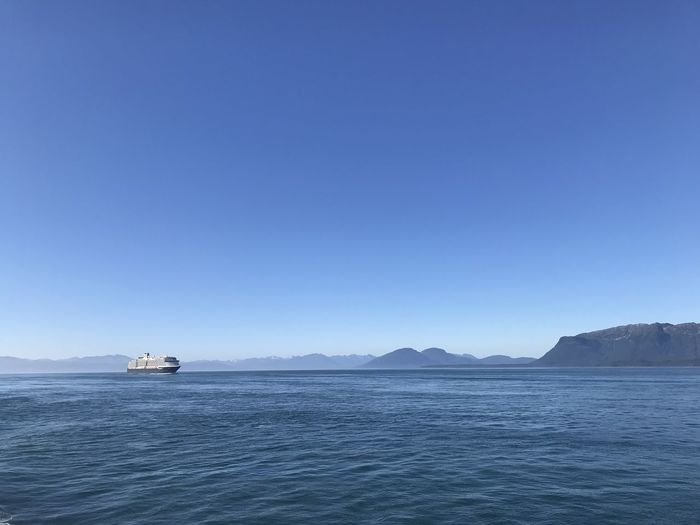 Beauty In Nature Blue Clear Sky Copy Space Day Idyllic Mode Of Transportation Mountain Nature Nautical Vessel No People Outdoors Passenger Craft Scenics - Nature Sea Sky Tranquil Scene Tranquility Transportation Water Waterfront