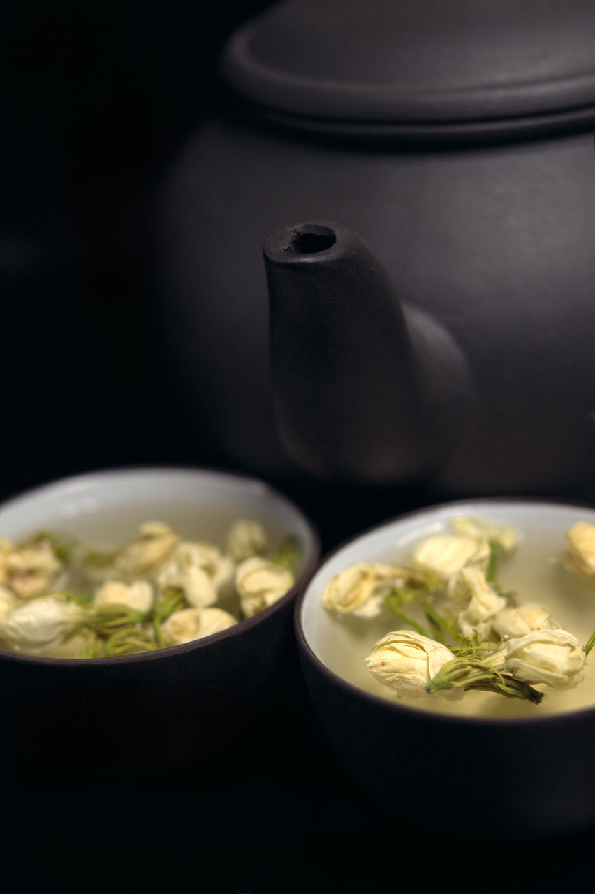 Close-Up Of Herbal Tea By Teapot
